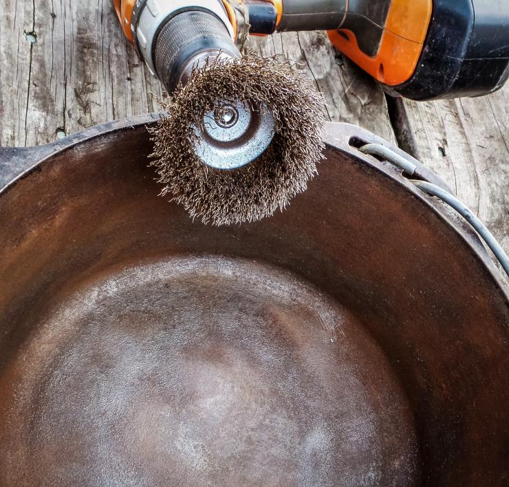 A wire brush on a cordless drill will remove even the heaviest rust from a pan.