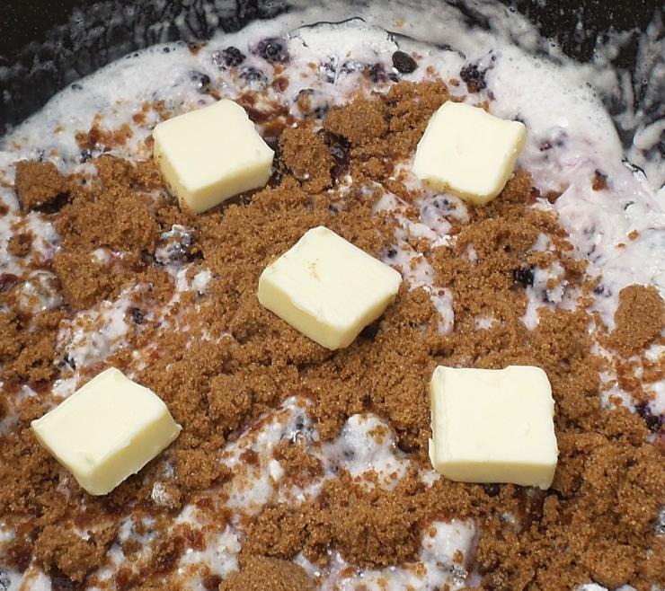 Simply add all the pre-measured ingredients to the Dutch oven, top with the cake mix, brown sugar and butter, then bake.