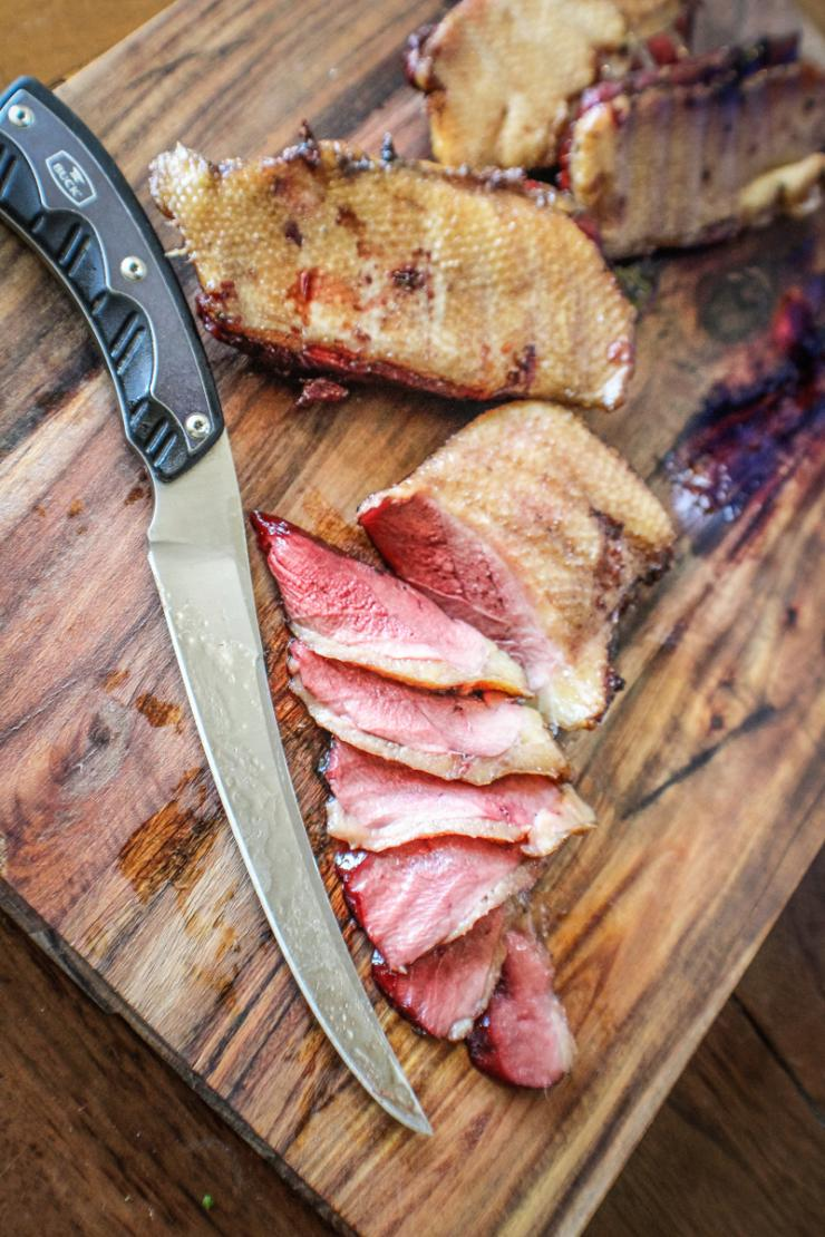Slice the medium-rare duck breast thinly against the grain for extra tender meat.