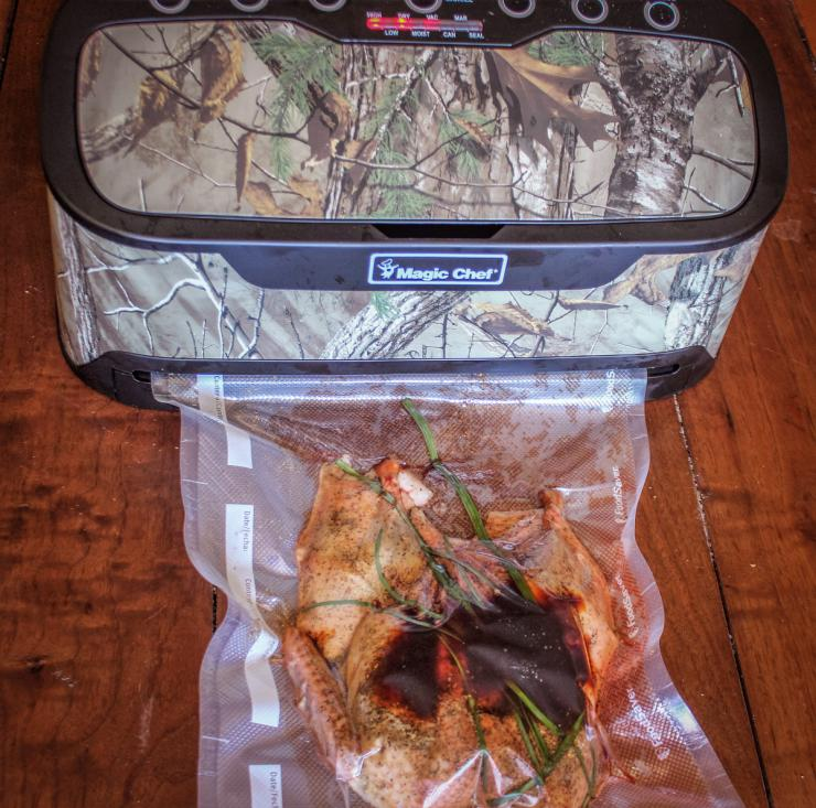 The new Magic Chef Vacuum Sealer has a handy bag compartment in the top and starts instantly when you insert the bag.