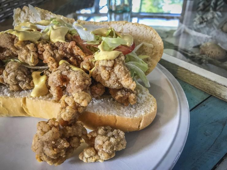 Pile the fried gator high on good bread and top it with the spicy remoulade sauce.