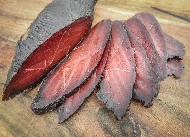 Slice the cured goose breast into thin strips and serve on crackers with cheese, peppers, or both.