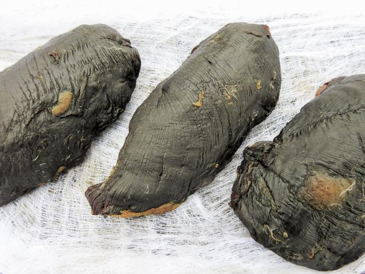 Once cured and smoked, the goose breast will be dark and will feel a bit leathery.