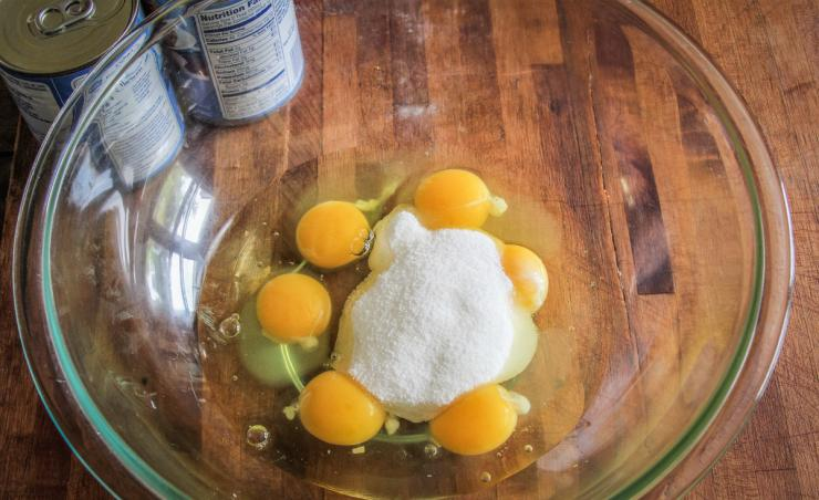 Start by mixing sugar into eggs.