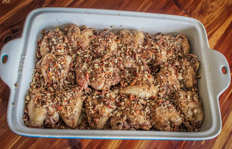 Move the seared quail to an oven proof dish and top with honey and pecans.