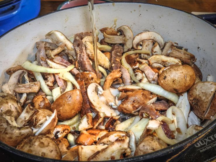 Pour the beer back into the pot before returning the rabbit to braise.