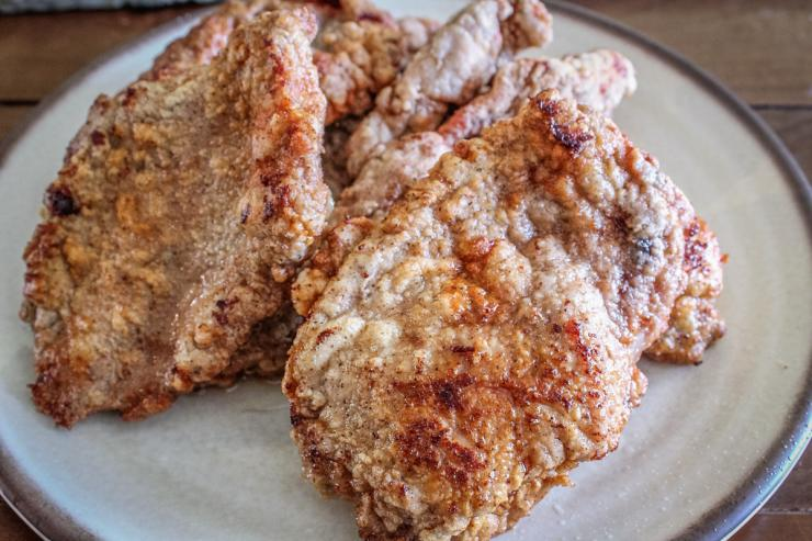 Dredge the turkey cutlets in seasoned flour and fry till crisp and just cooked through.