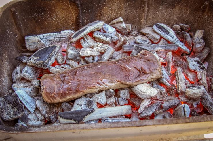 It only takes a couple minutes per side to cook the meat on the glowing hot coals.