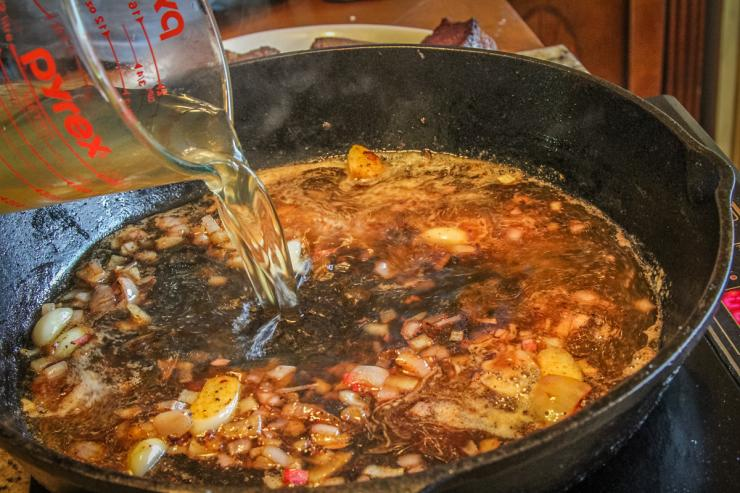 After searing the steaks, saute the shallots and deglaze the pan with stock.