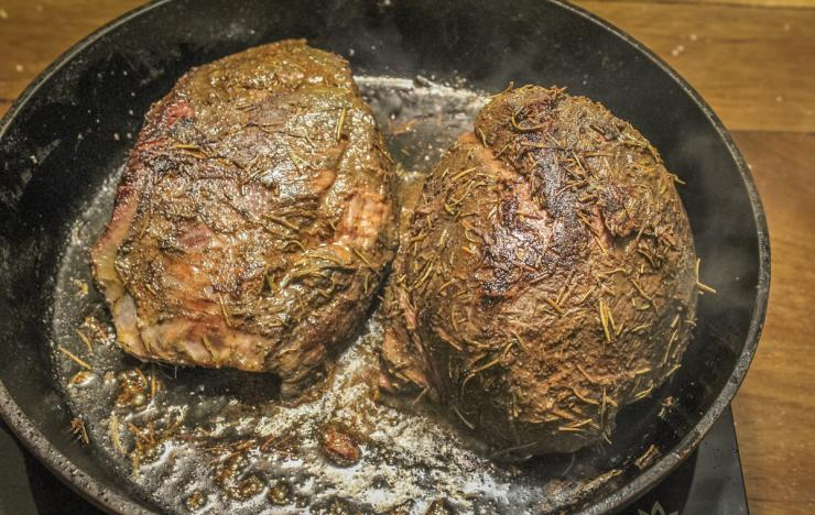 Sear the roasts in hot oil to brown the surface.
