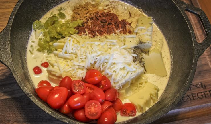 Mix all of the queso ingredients in a deep Lodge or other cast iron pan.