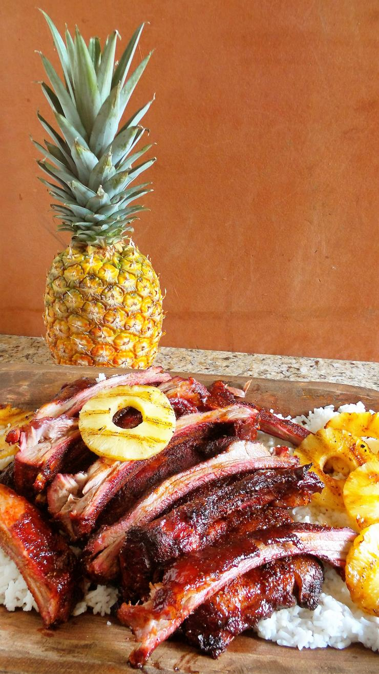 Tropical flavors like pineapple and coconut milk give the recipe a flavor not normally found in BBQ ribs.