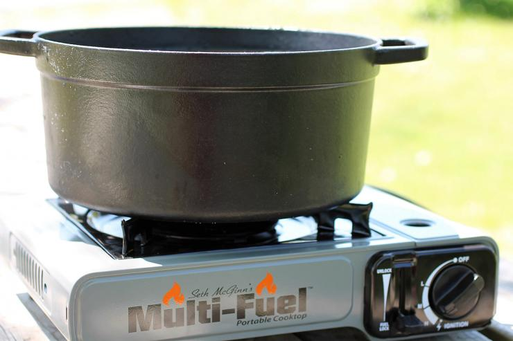 Seth McGinn's Mult Fuel Cooktop and a Dutch oven make the perfect pair for rendering outdoors.