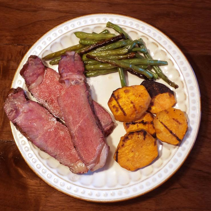 Sliced across the grain, the medium-rare steak was fork tender and delicious.