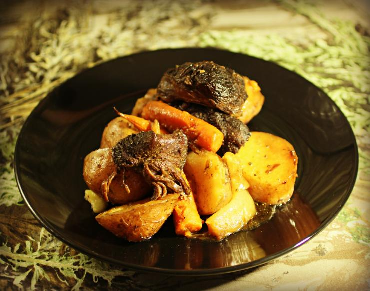 Slow roasted elk round with carrots, potatoes and onions.