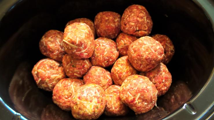 Place the meatballs in the slow cooker.