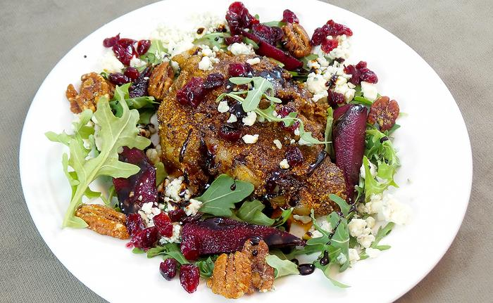 Serve the chop with fresh arugula, poached pears and cranberries and topped with Gorgonzola cheese and candied pecans.