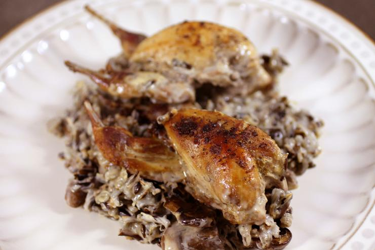 Plate by spooning rice and gravy onto plate and top with one to two quail per person.