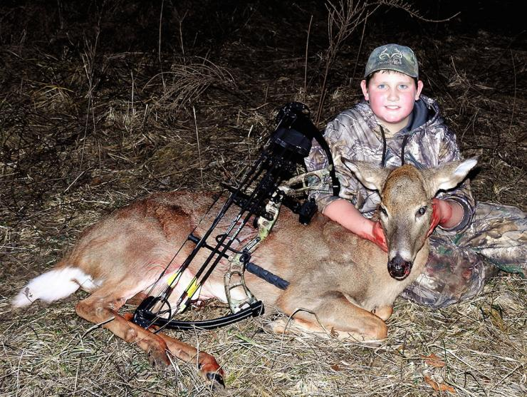 Michael's son, Potroast, poses with a nice, big doe he killed with his bow. (Michael Pendley photo)