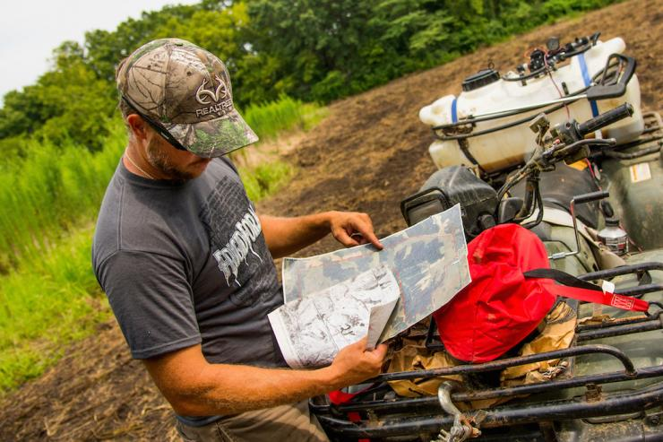 Studying a printed map helps you learn a property's features in a way that small digital copies can't. (Realtree photo)
