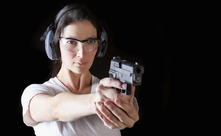 It doesn't take long when the shooting starts to see the fear in the husband's eyes when he sees just how good of a shot his wife is. (Phase4Studios/ Shutterstock photo)