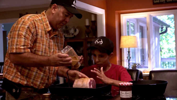 Chip and his dad show how they season the pork tenderloin before grilling.