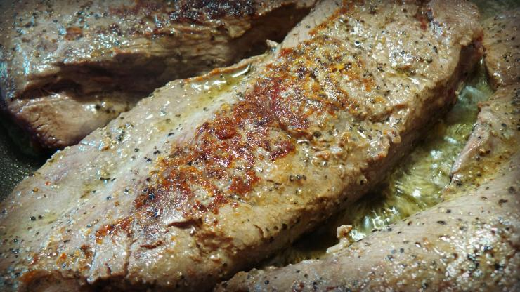 Sear the backstrap in olive oil over high heat, then finish in a 350 degree oven.