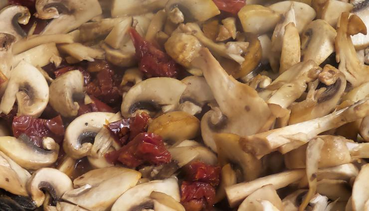 Saute the mushrooms, tomatoes, garlic and herbs in butter before adding cream.