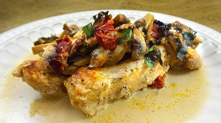 Make sure to spoon plenty of the cream sauce over the turkey, tomatoes and mushrooms.