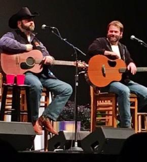 Daryle Singletary and Andy Griggs perform together on stage. -- Photo provided by Andy Griggs
