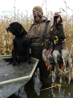 successful duck hunter with dog