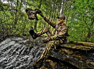 April showers bring wet feet. And push turkeys into open fields. (Bill Konway image)