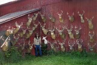 The author poses with bucks he's tagged over the years. (Dan Infalt photo)