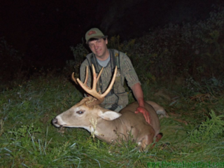 The author poses with a nice whitetail. (Dan Infalt photo)