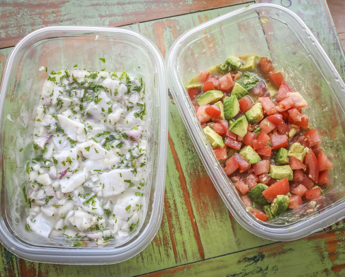 Mix the fish in one container, the tomato and avocado in another. Combine just before you are ready to eat.