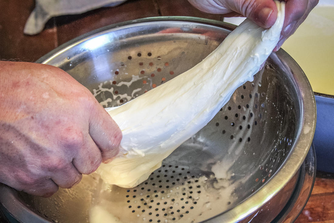 Stretch the cheese until it is shiny and firm.