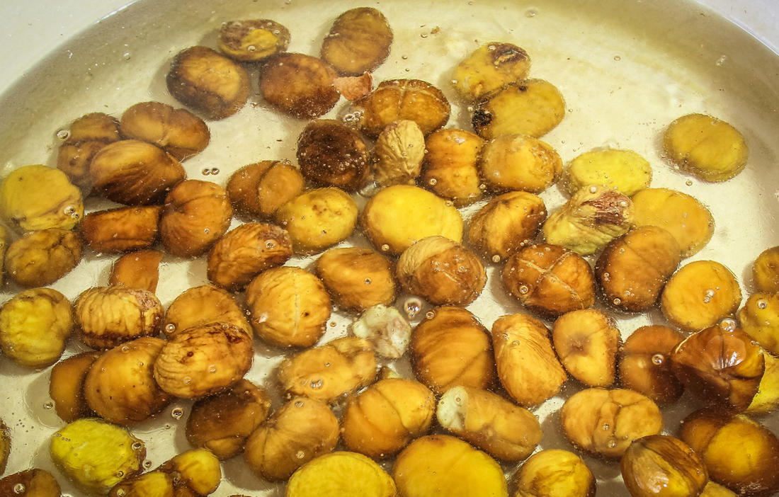 Simmer the chestnuts in the sugar water mixture.