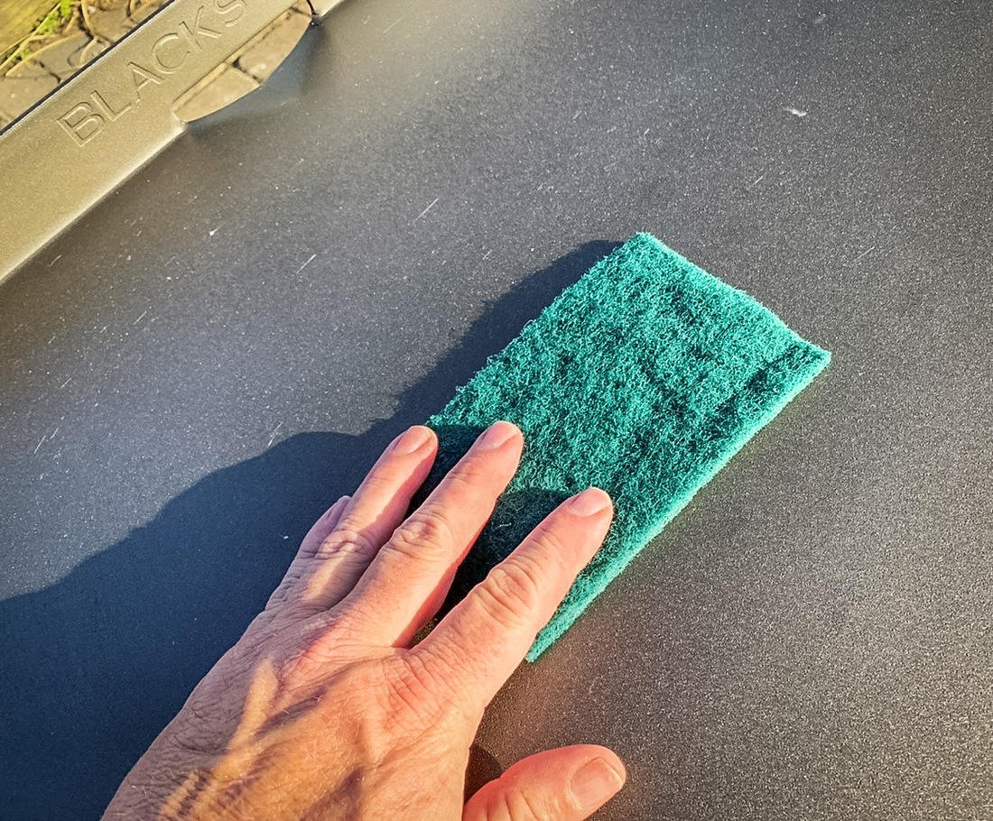 Use a Scotch Brite scouring pad to remove any rough spots.