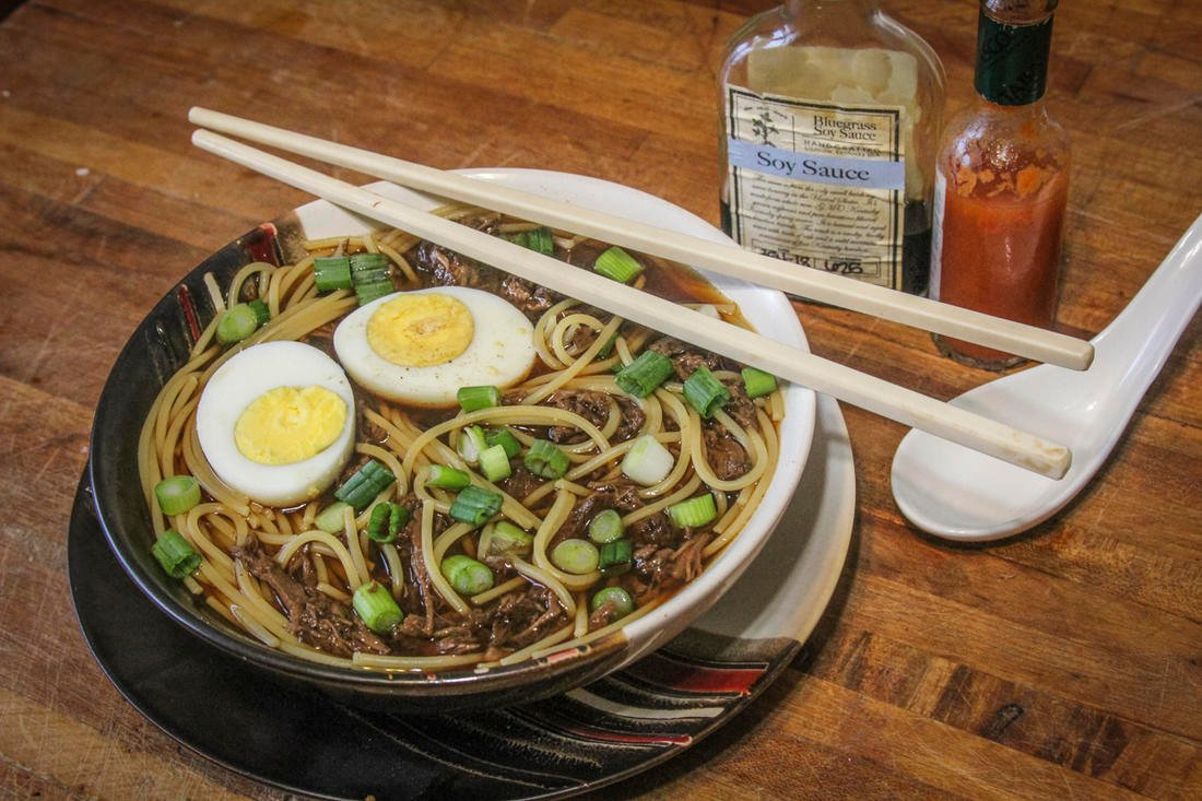 Serve the yakamein with cooked spaghetti noodles and lots of broth from the slow cooker.
