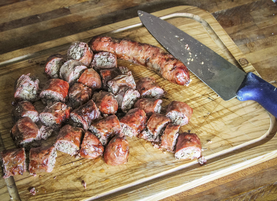 Slice the grilled sausage into bite-sized pieces.