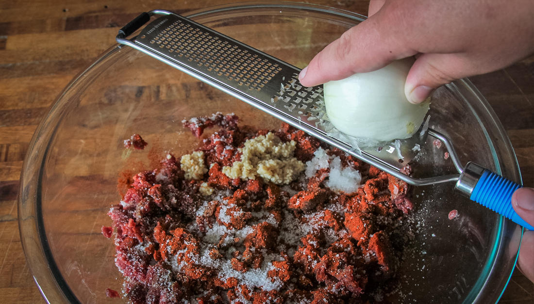 Use a grater to finely mince the onion.