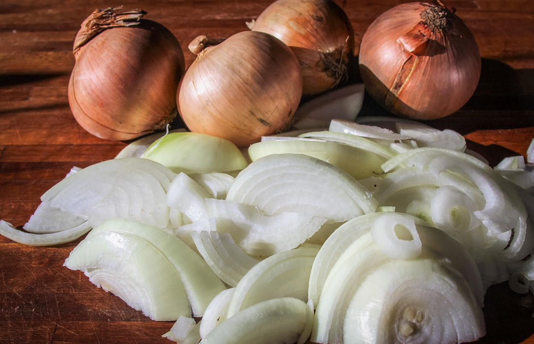 Slice the onions before adding to a heavy Dutch oven.