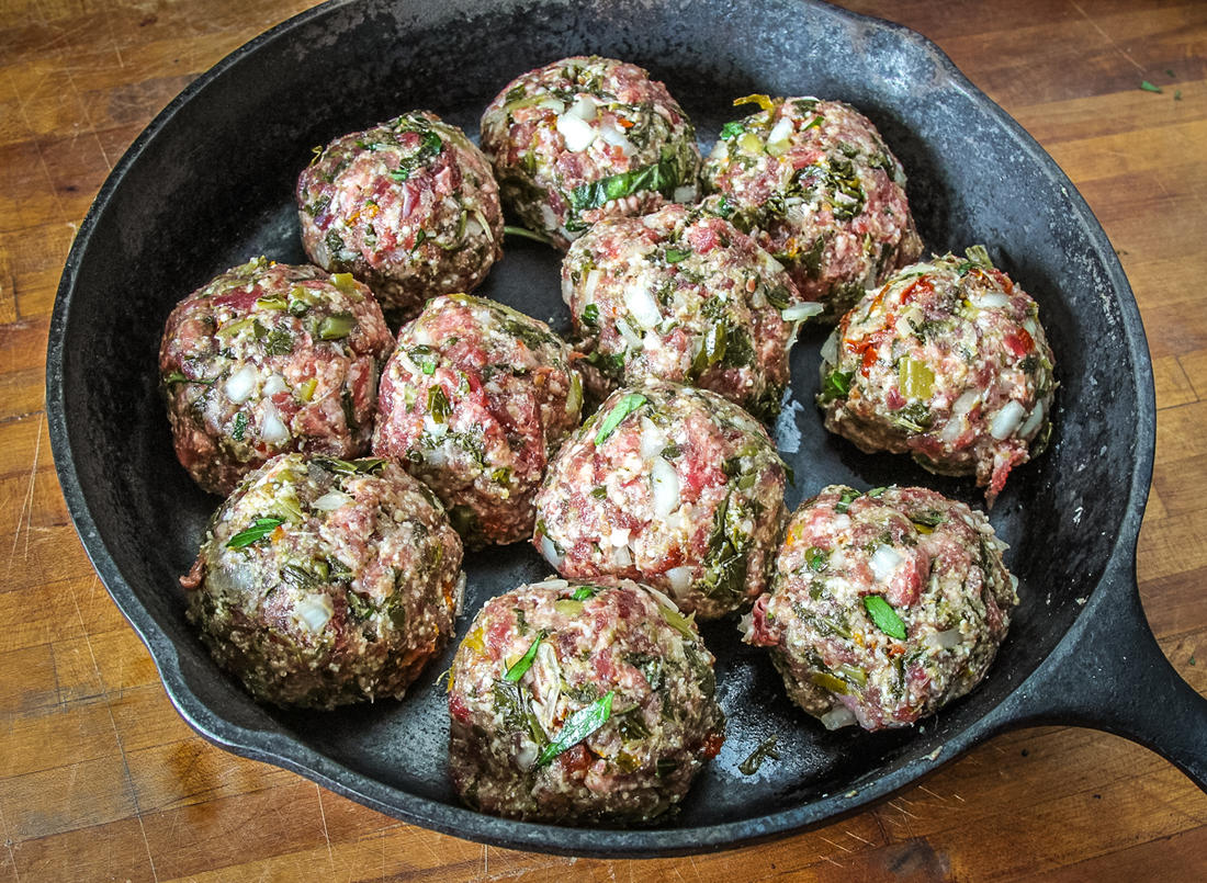 Form the meatballs and place in a cast iron skillet to grill.