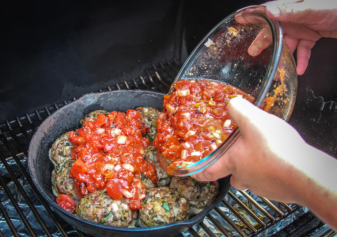 After the meatballs have cooked for 30 minutes, pour over the sauce and continue to grill.
