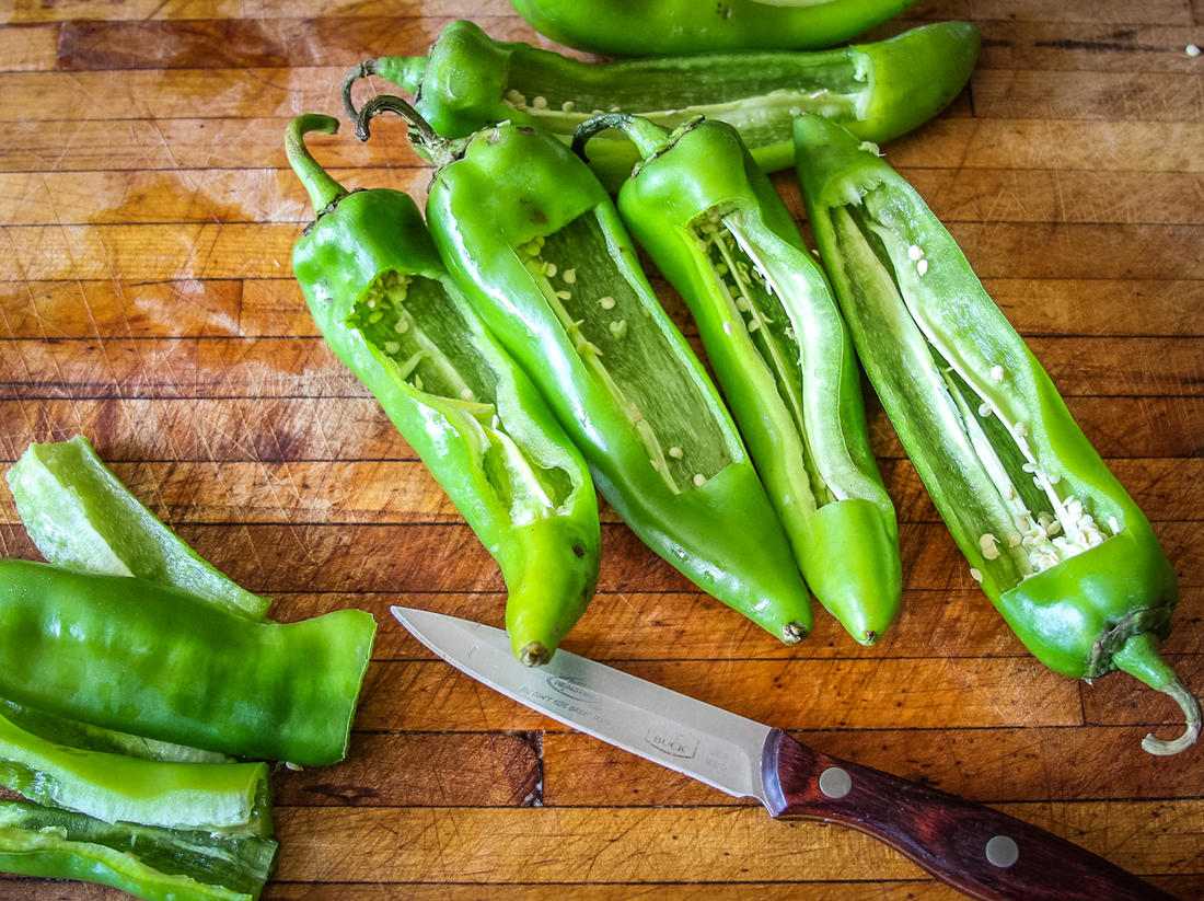 Remove a section of each pepper, then scoop out the seeds and ribs.