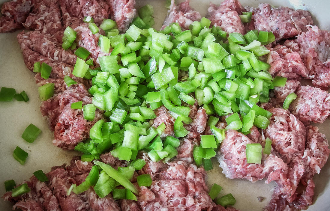 Dice the removed strips of pepper to cook with the sausage.