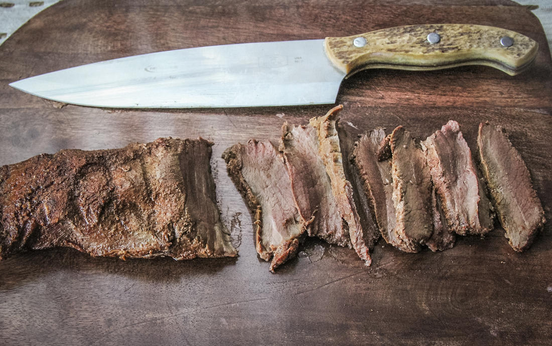 Grill the backstrap and cut into thin slices.