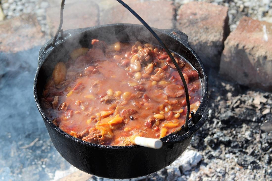 A Dutch oven is the perfect way to cook a large meal over a campfire.
