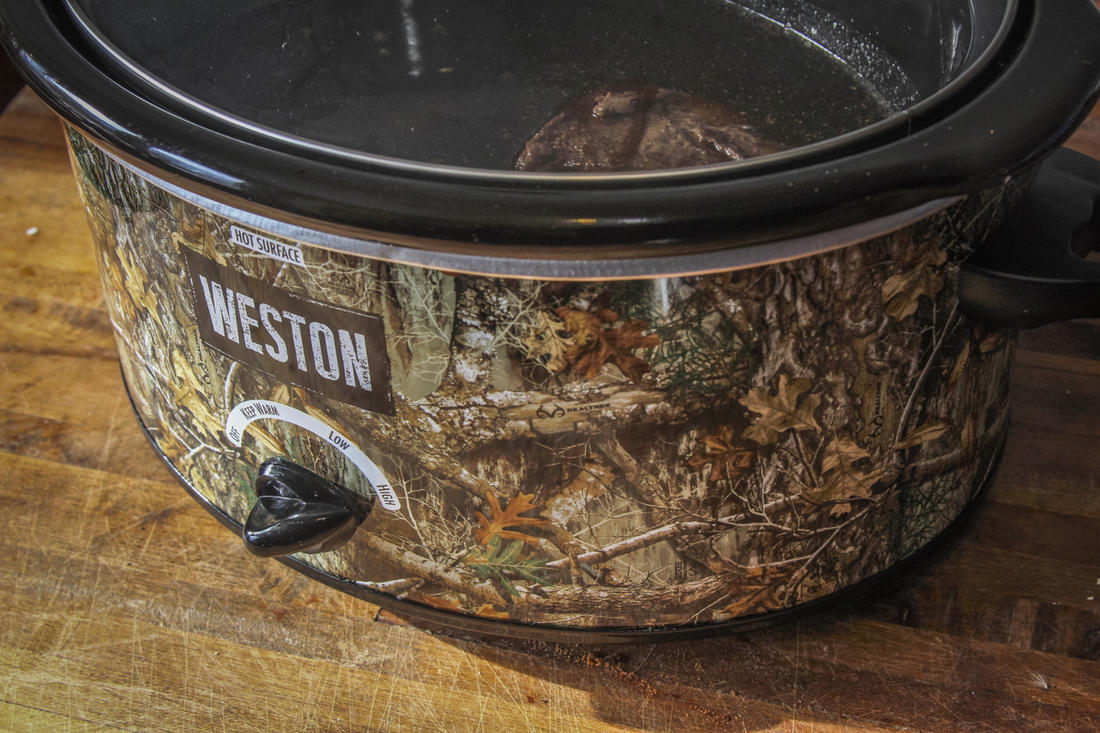 If your camp has electricity, use a Weston Realtree slow cooker to start a meal before heading out in the morning and it will be ready when you get back.