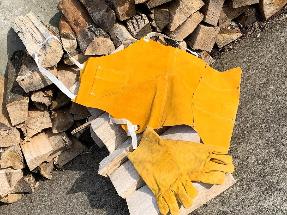 A bit of protective gear can help to prevent burns when cooking over an open fire.